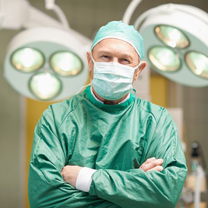 surgeon standing in a surgical operating room